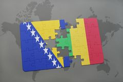Puzzle with the national flag of bosnia and herzegovina and mali on a world map Stock Photography