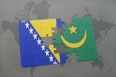 puzzle with the national flag of bosnia and herzegovina and mauritania on a world map Stock Photo
