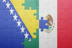 Puzzle with the national flag of bosnia and herzegovina and mexico. Concept royalty free stock photography