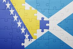 puzzle with the national flag of bosnia and herzegovina and scotland Royalty Free Stock Photos