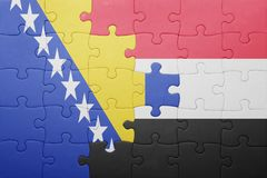 puzzle with the national flag of bosnia and herzegovina and yemen Stock Photos