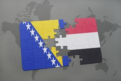 puzzle with the national flag of bosnia and herzegovina and yemen on a world map Royalty Free Stock Photos