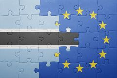 Puzzle with the national flag of botswana and european union Royalty Free Stock Images