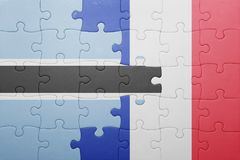 Puzzle with the national flag of botswana and france Royalty Free Stock Photo
