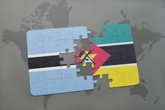 Puzzle with the national flag of botswana and mozambique on a world map Stock Photography