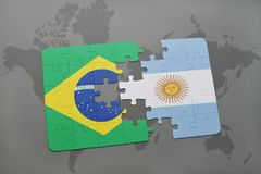 Puzzle with the national flag of brazil and argentina on a world map background. 3D illustration Stock Photo