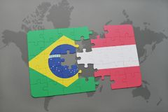 Puzzle with the national flag of brazil and austria on a world map background. 3D illustration Royalty Free Stock Image