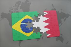 Puzzle with the national flag of brazil and bahrain on a world map background. 3D illustration Stock Image