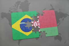 Puzzle with the national flag of brazil and belarus on a world map background. 3D illustration stock image