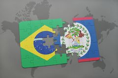 Puzzle with the national flag of brazil and belize on a world map background. 3D illustration royalty free stock photography