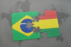 Puzzle with the national flag of brazil and bolivia on a world map background. 3D illustration Stock Photo