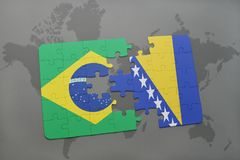 Puzzle with the national flag of brazil and bosnia and herzegovina on a world map background. 3D illustration royalty free stock photo