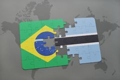 Puzzle with the national flag of brazil and botswana on a world map background. 3D illustration Royalty Free Stock Image