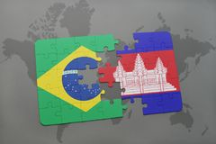 Puzzle with the national flag of brazil and cambodia on a world map background. 3D illustration Royalty Free Stock Image