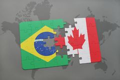 Puzzle with the national flag of brazil and canada on a world map background. 3D illustration Stock Photos