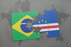 Puzzle with the national flag of brazil and cape verde on a world map background. 3D illustration Royalty Free Stock Image