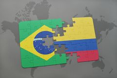Puzzle with the national flag of brazil and colombia on a world map background. 3D illustration Royalty Free Stock Photos