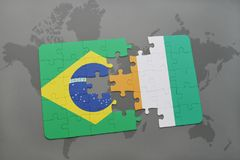 Puzzle with the national flag of brazil and cote divoire on a world map background. 3D illustration Royalty Free Stock Photos