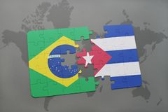 Puzzle with the national flag of brazil and cuba on a world map background. 3D illustration Royalty Free Stock Photo