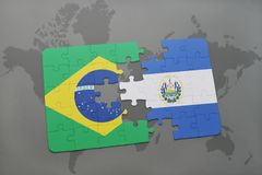 Puzzle with the national flag of brazil and el salvador on a world map background. 3D illustration stock image