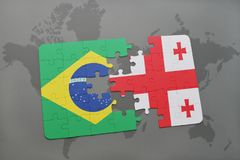 Puzzle with the national flag of brazil and georgia on a world map background. 3D illustration royalty free stock images