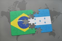 Puzzle with the national flag of brazil and honduras on a world map background. 3D illustration stock photo