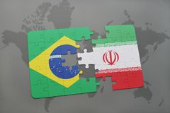 Puzzle with the national flag of brazil and iran on a world map background. 3D illustration stock images