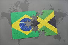 Puzzle with the national flag of brazil and jamaica on a world map background. 3D illustration Stock Photos