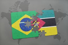 Puzzle with the national flag of brazil and mozambique on a world map background. 3D illustration Stock Photos