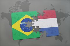 Puzzle with the national flag of brazil and netherlands on a world map background. 3D illustration Stock Images