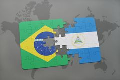 Puzzle with the national flag of brazil and nicaragua on a world map background. 3D illustration Stock Images