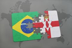 Puzzle with the national flag of brazil and northern ireland on a world map background. 3D illustration Royalty Free Stock Photo