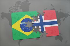 Puzzle with the national flag of brazil and norway on a world map background. 3D illustration stock image