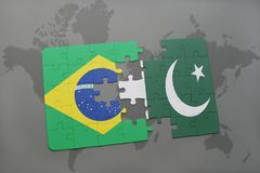 Puzzle with the national flag of brazil and pakistan on a world map background. 3D illustration royalty free stock photography