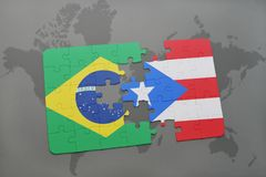 Puzzle with the national flag of brazil and puerto rico on a world map background. 3D illustration Royalty Free Stock Image
