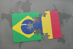 Puzzle with the national flag of brazil and romania on a world map background. 3D illustration stock photos