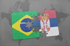 Puzzle with the national flag of brazil and serbia on a world map background. 3D illustration royalty free stock photos