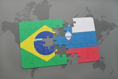 Puzzle with the national flag of brazil and slovenia on a world map background. 3D illustration royalty free stock photo