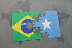 Puzzle with the national flag of brazil and somalia on a world map background. 3D illustration Stock Photo