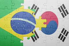 Puzzle with the national flag of brazil and south korea. Concept royalty free stock photo