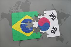 Puzzle with the national flag of brazil and south korea on a world map background. 3D illustration royalty free stock images