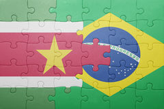 Puzzle with the national flag of brazil and suriname Royalty Free Stock Photography