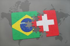 Puzzle with the national flag of brazil and switzerland on a world map background. 3D illustration Royalty Free Stock Photos