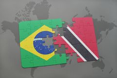 Puzzle with the national flag of brazil and trinidad and tobago on a world map background. 3D illustration Stock Image