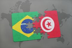 Puzzle with the national flag of brazil and tunisia on a world map background. 3D illustration Stock Image