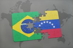 Puzzle with the national flag of brazil and venezuela on a world map background. 3D illustration Royalty Free Stock Photos