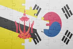 Puzzle with the national flag of brunei and south korea. Concept royalty free stock image
