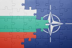 Puzzle with the national flag of bulgaria and nato. Concept stock images