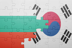 Puzzle with the national flag of bulgaria and south korea. Concept stock photography