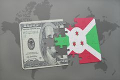 puzzle with the national flag of burundi and dollar banknote on a world map background. Stock Images